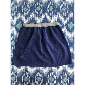 Subtle pattern navy blue skirt with gold band